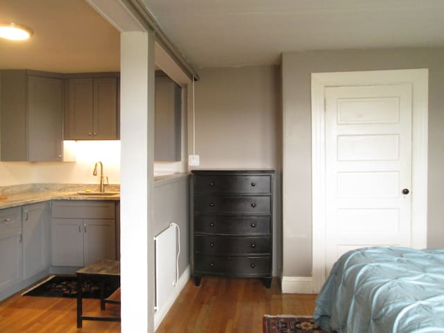Half wall separates kitchen from main room