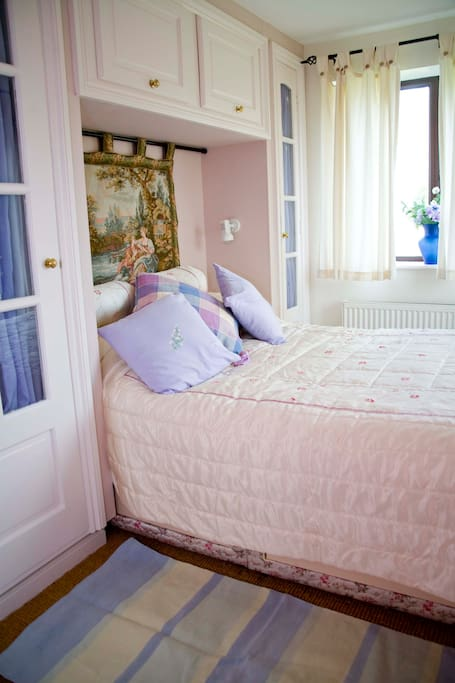 The main bedroom which overlooks the lake.