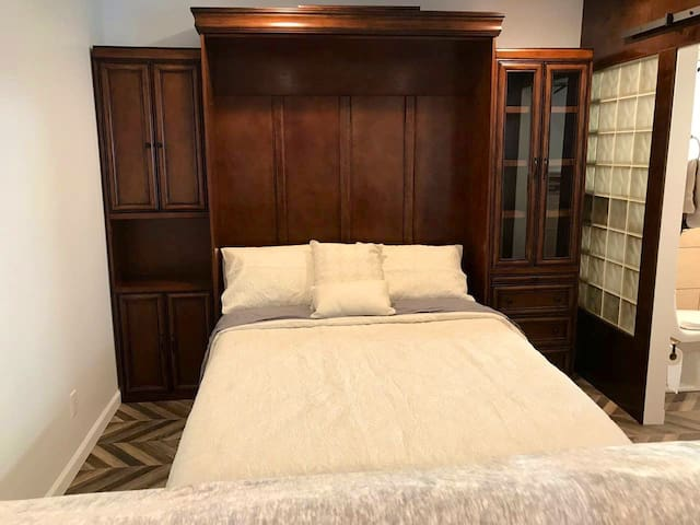 Queen sized Murphy Bed with firm yet comfortable mattress.