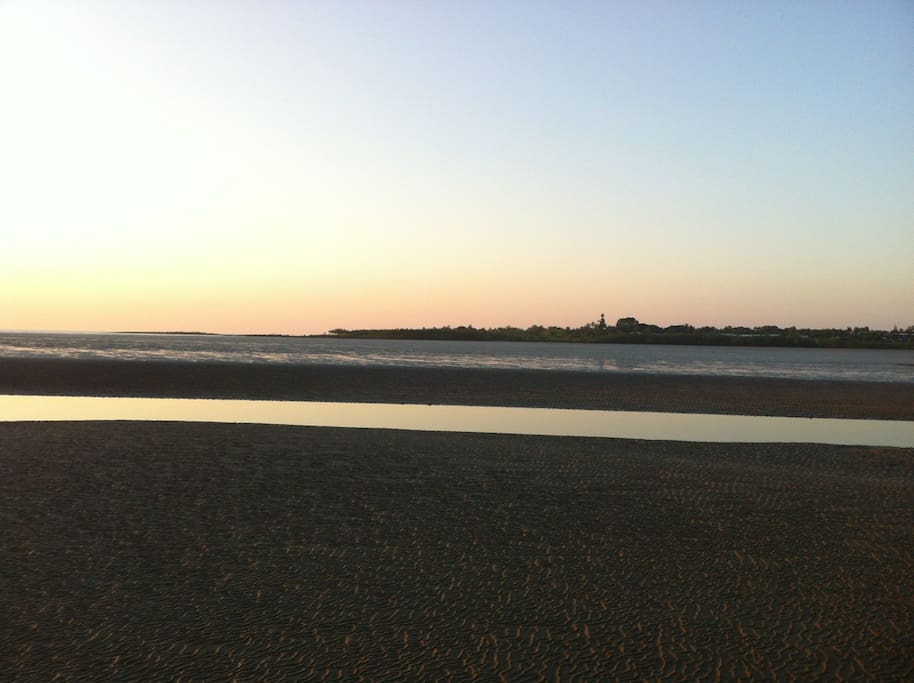 Walk the sandflats at low tide minutes from the CBD