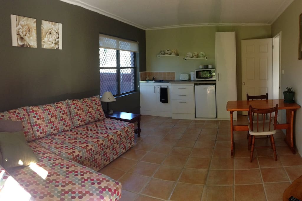 Lounge area with kitchenette and dining table