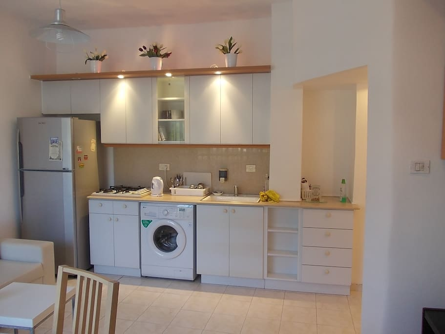 Excellent kitchen with huge refrigerator/freezer, 4-top gas stove, kettle, microwave and oven (microwave and oven are inside the cabinets).