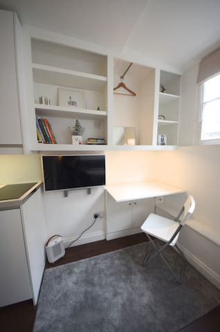 Shelves, hanging space and fold down desk