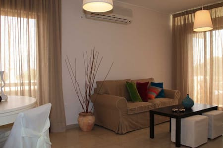 In a quiet green residential area by the seaside, located only 30 minutes drive from the Athens International Airport and 45 minutes from the Acropolis and the center of Athens(bus service every 45 minutes) one furnished apartment is offered for rent