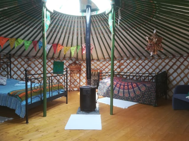 Pomegranate, a three person yurt, with wood burning stove