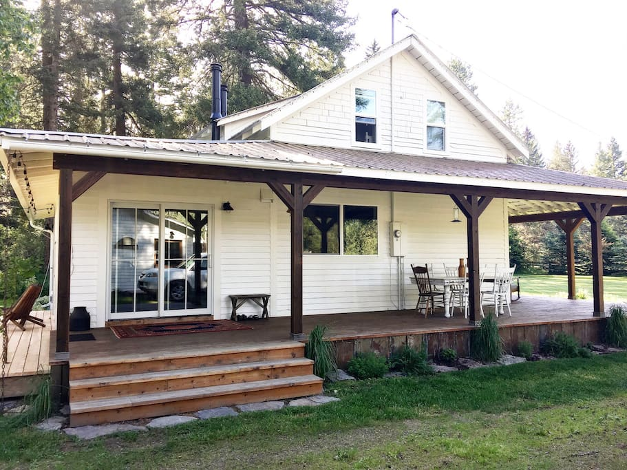 Side entrance, almost 900 sq ft of porch/decks to choose from!
