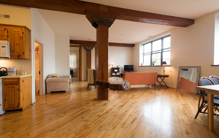 Beautiful reclaimed wood floors, salvaged from a nearby warehouse in 1985