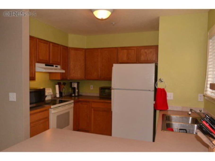 Well-stocked large kitchen is available for your use.
