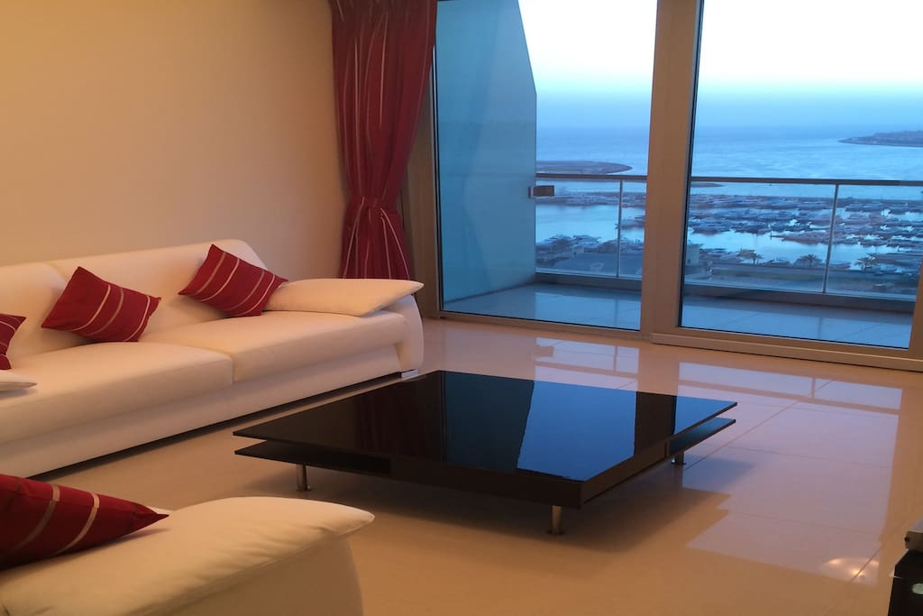 Living room that offers panoramic views over the sea and the palm. It also offers 2 sofa beds (with proper mattresses when opened) perfect for 3 sleeps. the living room also offers blackout curtains for super comfort.