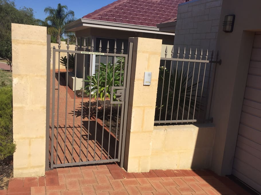 Secured entrance gate with intercom / bell