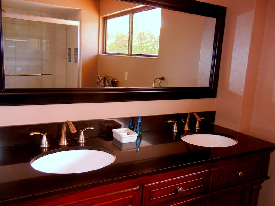 Private bathroom with granite and marble shower.