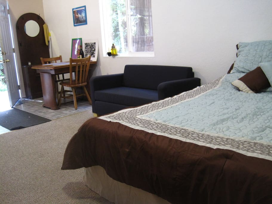 Couch pulls out to make a bed.