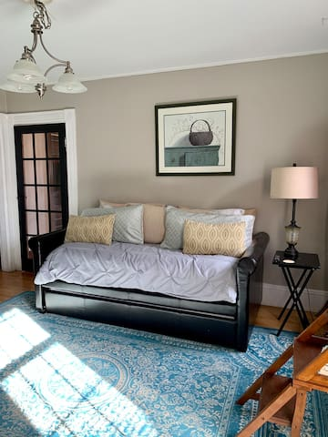 Living room- 50 in smart TV, twin trundle bed to accommodate 2 more guest