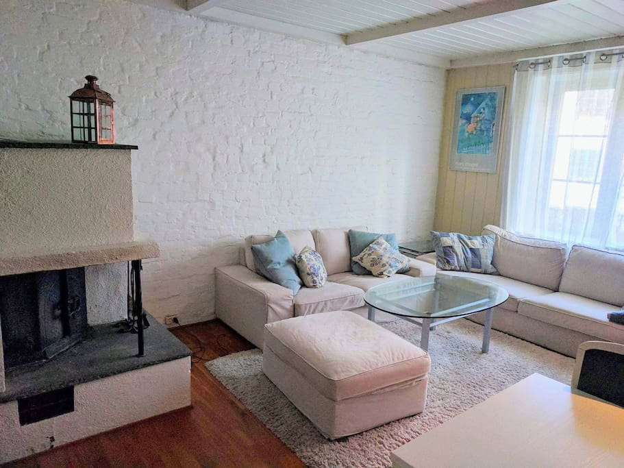The appartement has a big living room with two sofas, dinning table for 4 persons and a TV.