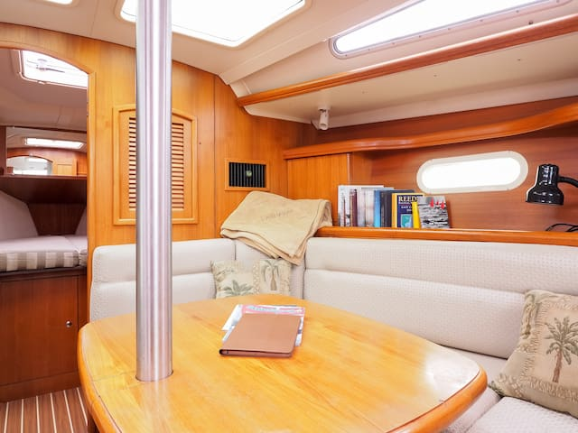 Main salon table and booth.  Forward cabin with v-berth sleeps 2.