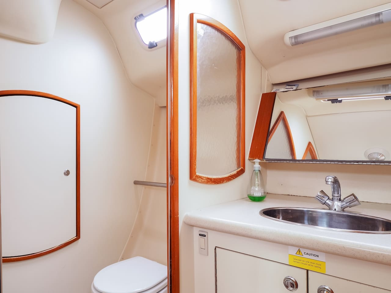 Head (bathroom) with separate washbasin and toilet areas.