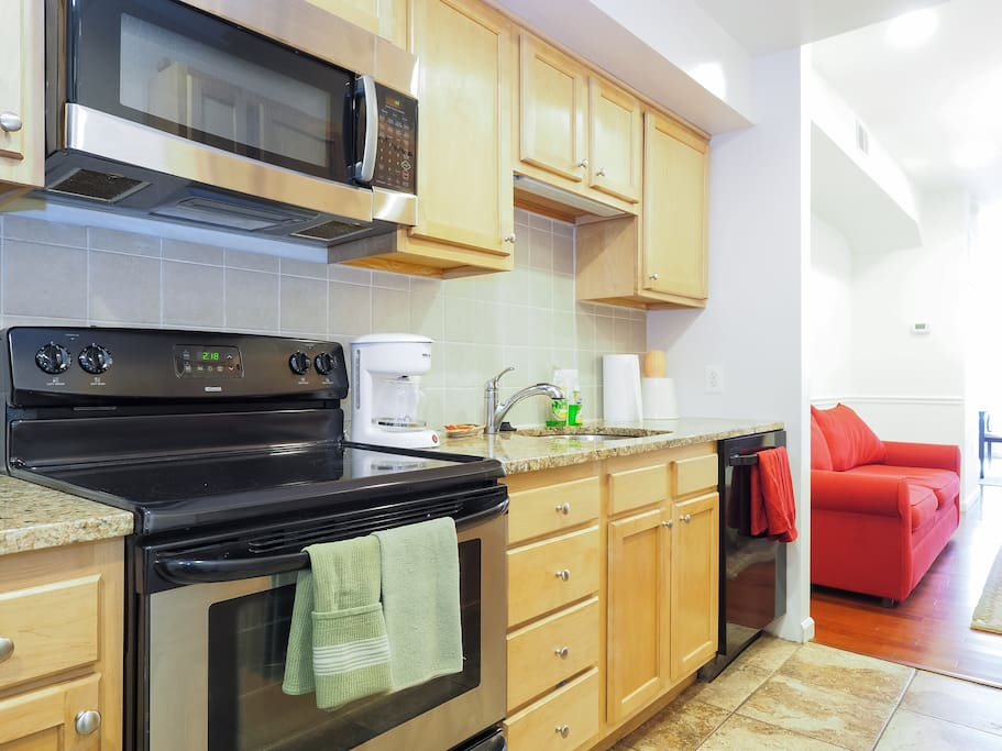 Kitchen boasts granite countertops, maple cabinets, gourmet sink and more.