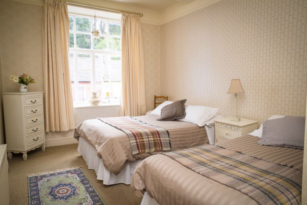 Front Bedroom/Family Room. Double bed and single bed. En suite.