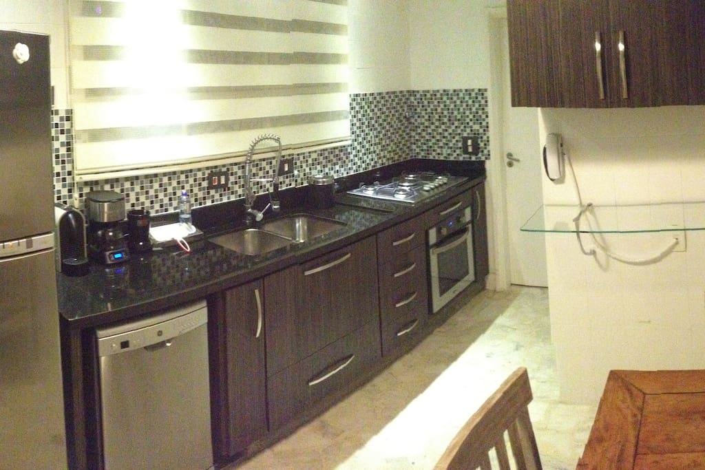 Full Equiped Kitchen: Dishwaher, Eletric/Propane Oven, cooktop stove, refrigerator, microwave, blender, coffee maker, cutlery, glasses, china