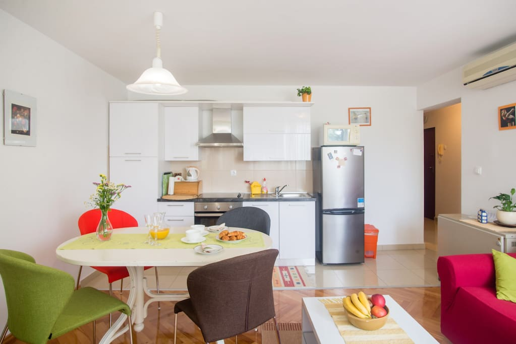 Kitchen with oven,microwave oven and fridge.