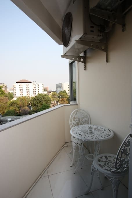 Cosy Balcony with a view over bustling Nimmanhaemin Road with all of it's Cafes and Shops