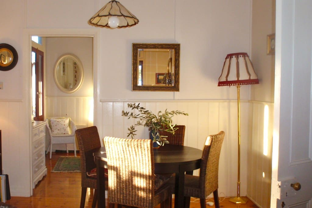 The dining table with a glimpse of the 3rd bedroom
