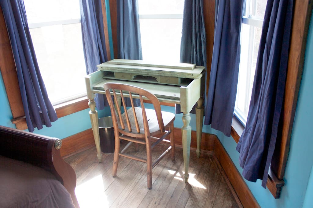 Small writing desk overlooking Plain Street.