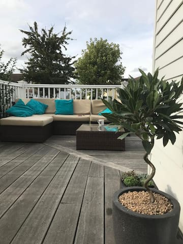 Comfy Sofa's on the deck seat 5 comfortably but there are also outdoor beanbags for guest use.