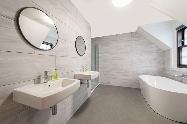 Spacious bathroom with shower & bath