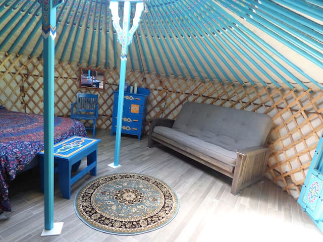 Yurt has fold out futon