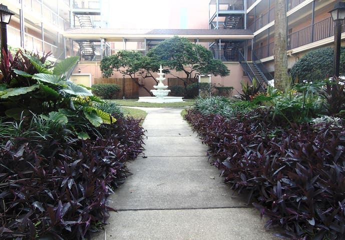 The complex has tranquil tropical gardens