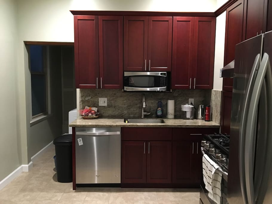 Remodeled, fully stocked spacious kitchen with modern stainless steel appliances.