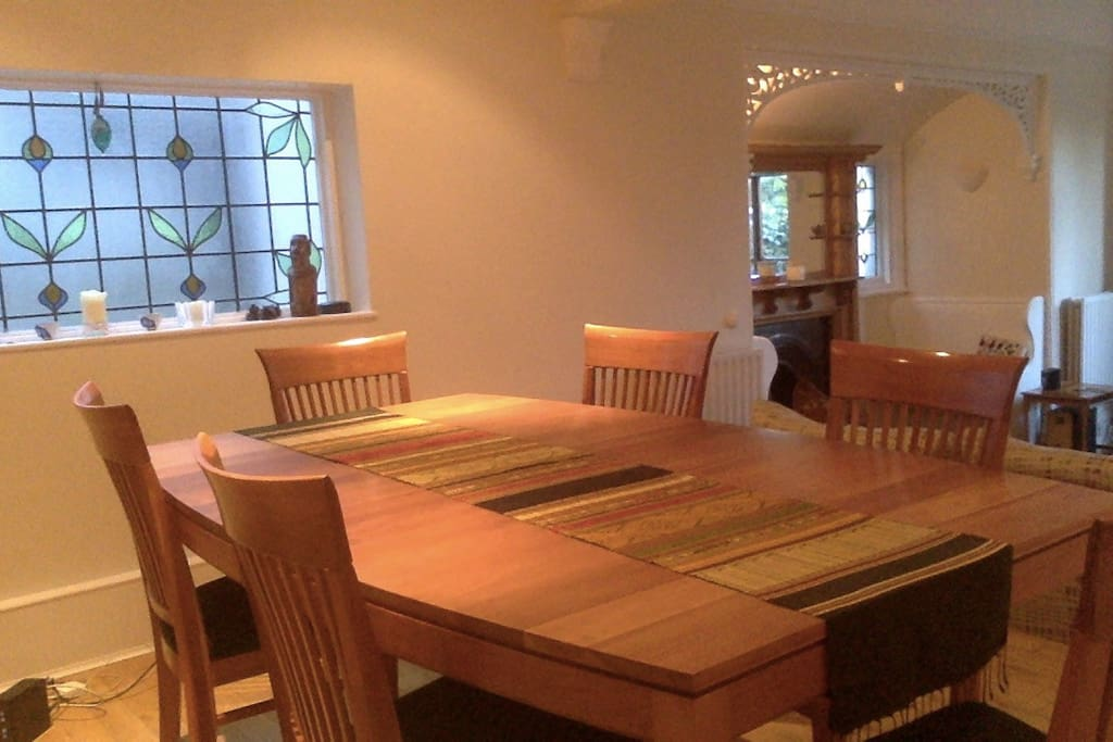 Dining and lounge open to leafy garden.