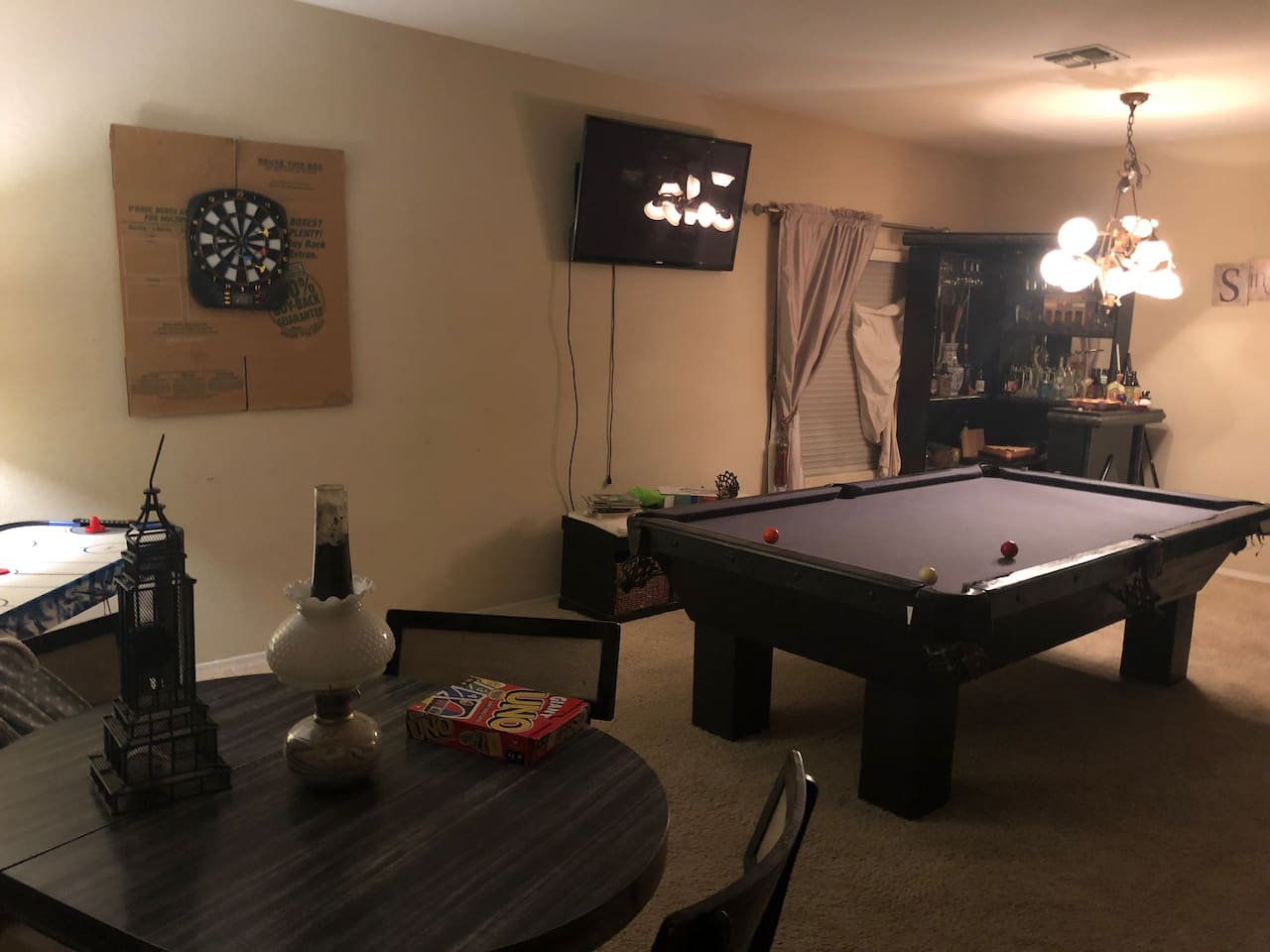 Billiards room at entry of home.