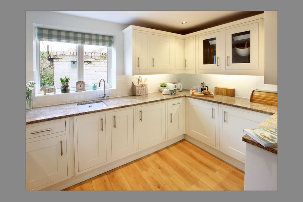 The brand new kitchen with granite worktops and modern appliances.