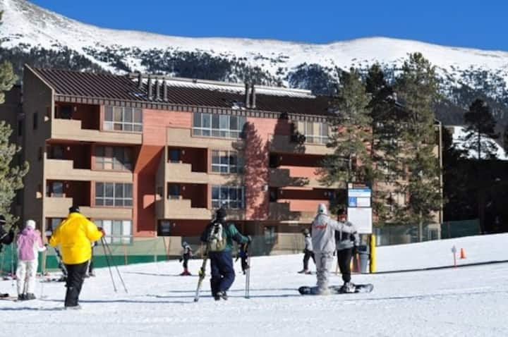 Ski-in/ski-out Village condo with mountain views, shared hot tub, and fireplace