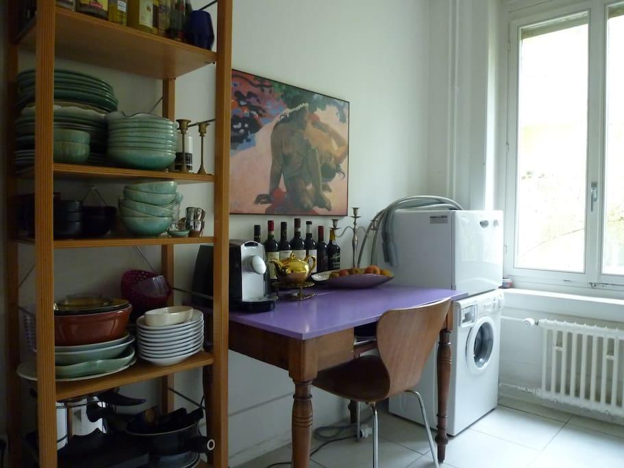 kitchen with washing machine, dish washer, coffee machine