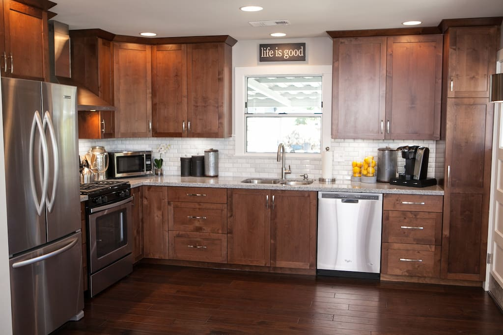Custom cabinets, granite counter tops, Carrara Marble backsplash, stainless appliances, and Kitchen fully stocked with cooking utencils, pots/pans, dishes, and silverware and more.   Gas stove amongst other appliances.