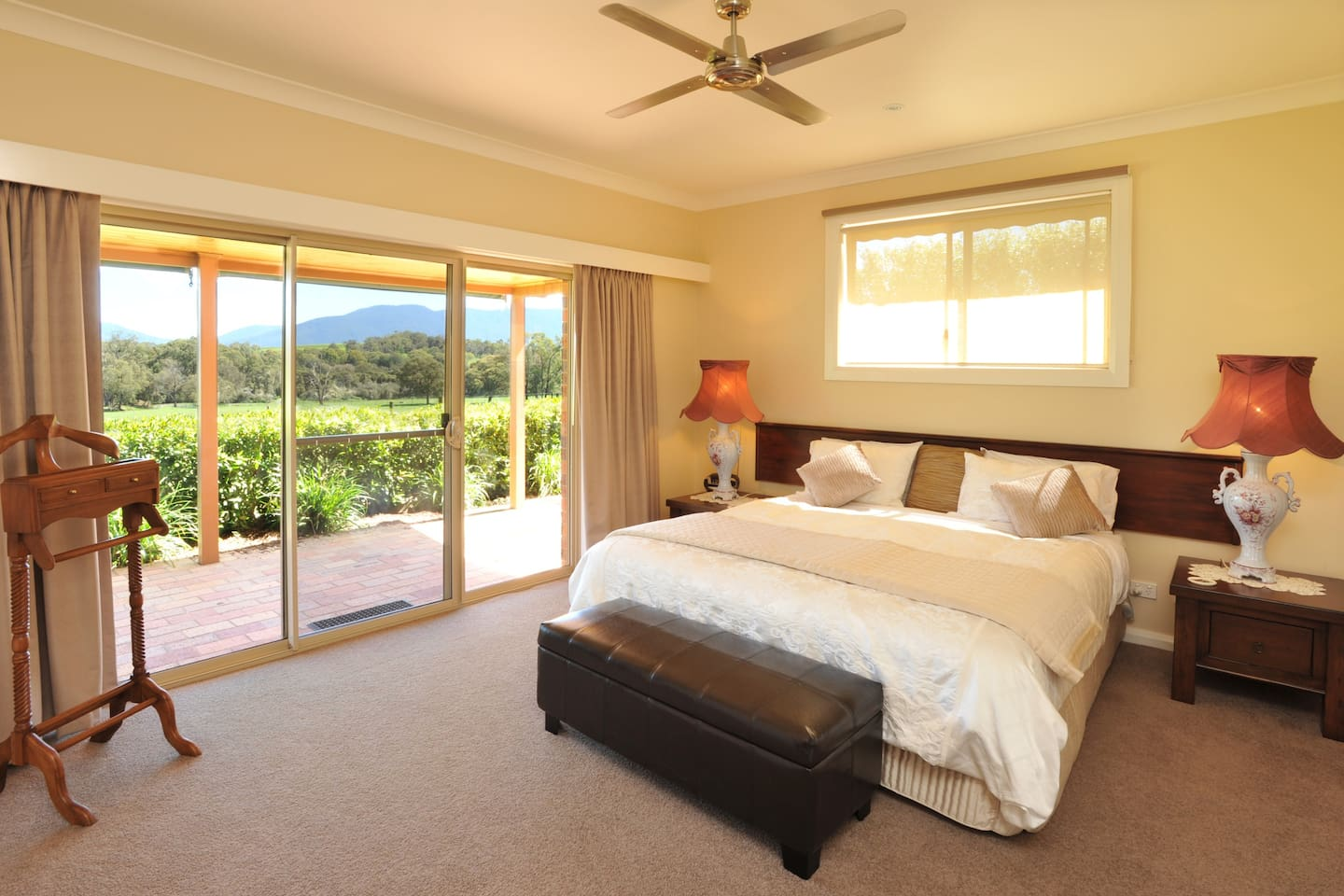 A spacious bedroom with king size bed, LCD television and uninterrupted views over farmland and mountain ranges.
