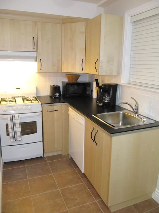 kitchen with 6 appliances. Comes stocked with coffee, teas,all condiments, china