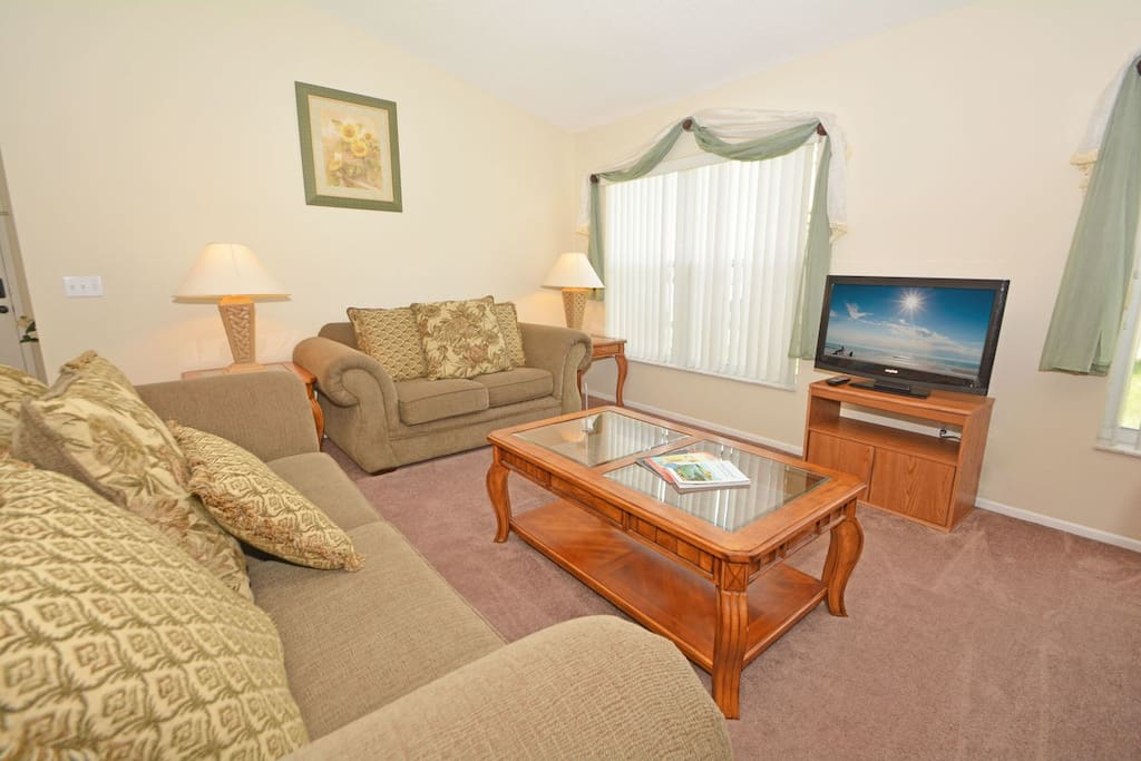 Formal seating area with large flatscreen TV