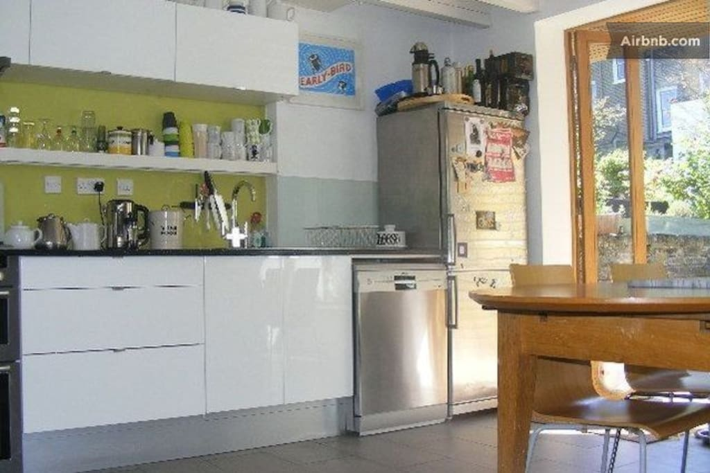 large kitchen, heart of the house, dish washer and very large kitchen table, bench seats up to 14