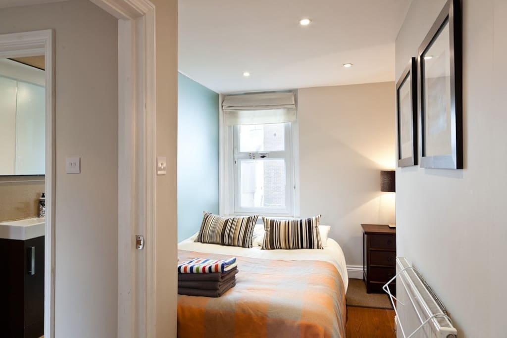 Double bedroom with double bed, wardrobe, bright windows, blackout blinds, carefully decorated