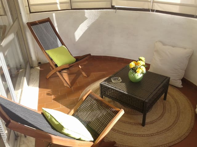 Close balcony with 2 chairs and 2 large pillows to relax and have a nice time