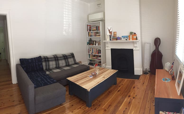 Daytime shared living room with a sofa bed which I use at night while guests are staying.