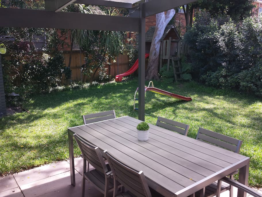Garden and outdoor entertaining area with treehouse