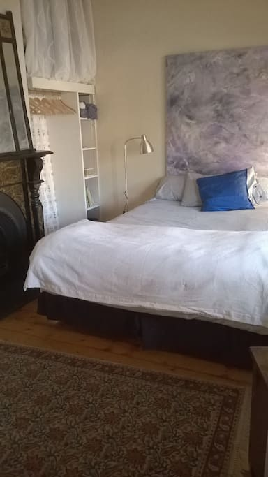 very comfortable queen bed, two built in robes and a decorative period fireplace make a cosy space to relax.
