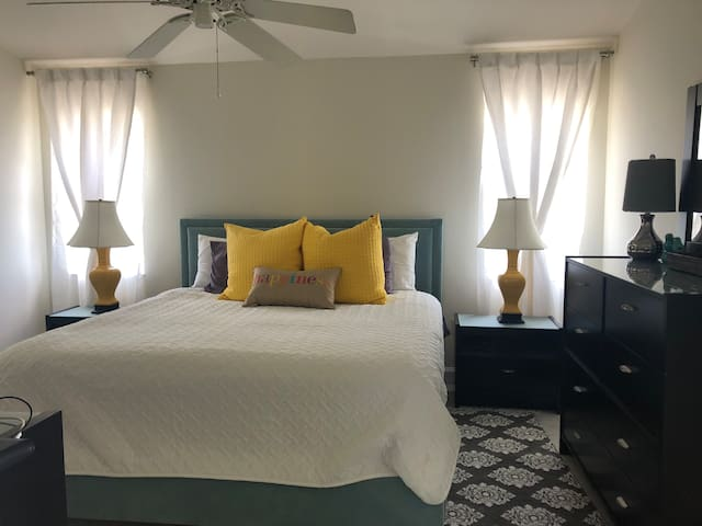 Large comfortable room with beautiful king size bed, enough dresser and chest space for clothes and walk in closet. Flat screen TV.
