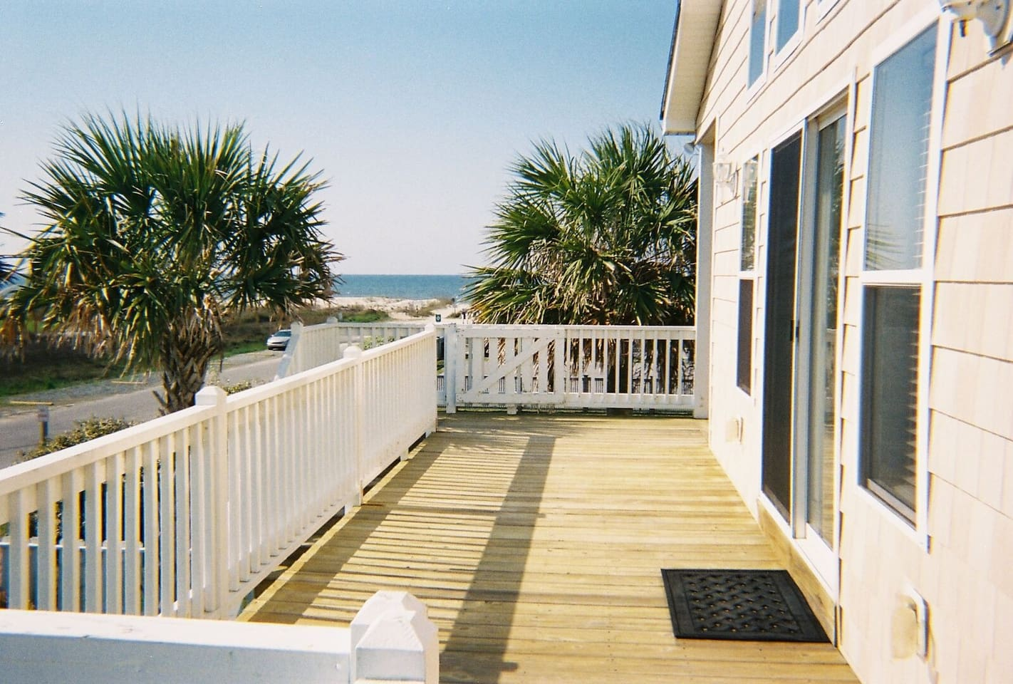 Your private deck with ocean view. This entrance is used for guests only. You are steps from the beach.