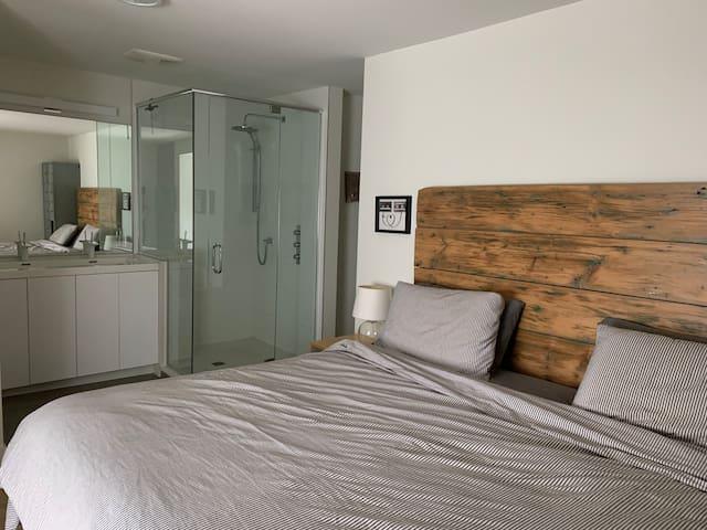 Master bedroom with an ensuite washroom.
